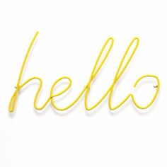 Yellow Hello Metal Coat Rack: Inspired byhandwrittenneons, this yellow Hello Coat Rack, made from a single length of powder-coated steel, isdesigned to welcome you home, and offer a place to hang your coat or bag.
