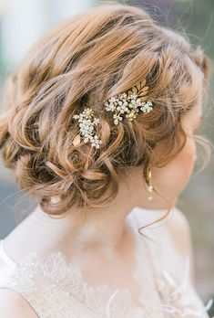 Brides.com: . A gold leaf hair clip with crystal flower details from One World Design.