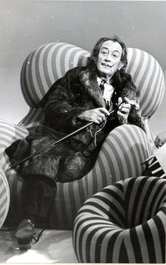 "The press cutting, reads : ""Vendredi 1er Octobre 20 15 H. Un rire par jour, Salvador Dali"". Dali is portrayed on a Pop Art Settee in his fur coat holding his trademark stick. Obviously this was for a French Television or radio programme entitled ""a Laugh a day"""