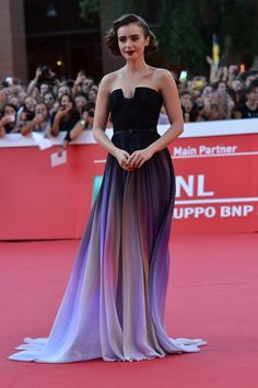 Lily Collins...this dress is a dream. But I don't like her hair & makeup with it
