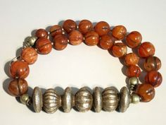 Nepalese carnelian melon bead necklace with Tilhari silver bead.