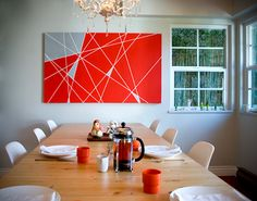 Here's an inexpensive, do-it-yourself wall art project from The New Domestic. Get a large canvas, mark off lines with tape, and fill in the gaps with paint.