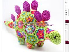 http://www.ravelry.com/patterns/library/puff-the-magic-stegosaurus-african-flower-crochet-pattern