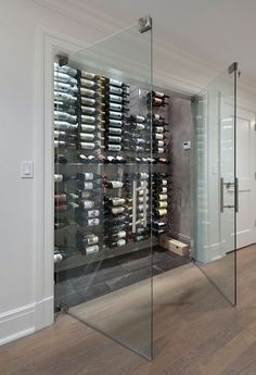 Wine Cellar - Design photos, ideas and inspiration. Amazing gallery of interior design and decorating ideas of Wine Cellar in dining rooms, kitchens, basements by elite interior designers - Page 3 Glass Wine Cellar, Home Wine Cellars, Wine Cellar Design, Wine Cellar Modern, Modern Wine Rack, Cave A Vin Design, Best Wine Coolers, Kitchen Pantry Doors, Kitchen Floor