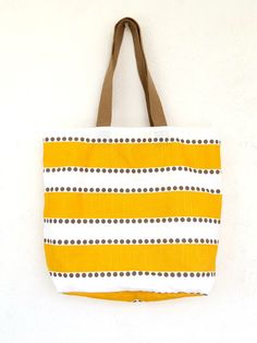 Yellow Reversible Tote - Three Cords Haiti || Three Cords is a social enterprise founded in September 2010 to train, employ, and empower Haitian men and women. Our mission is to provide opportunities for physically handicapped  women and men, and to show them that they are both beautiful and valuable.  We do this by training our employees as artisans in a loving, community oriented environment.