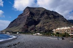 'View of the Americas' overlooks the beach and hotels of Gran Rey resort.~ Canary Islands
