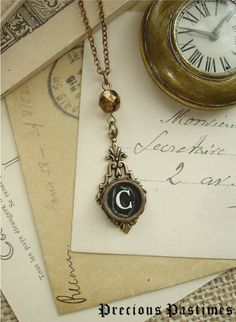 Typewriter Key Jewelry - Letter C Vintage Typewriter Key Necklace. Black Initial in Antiqued Brass with Sparkling Bronze Metallic Crystal.