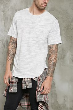A textured marled knit tee featuring a crew neckline, left chest patch pocket, short sleeves, and a curved hem.