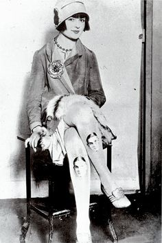 "Miss Kitty Lee - A Baltimore girl, wears her boyfriend's photograph on her stockings, 1920s. Scanned from ""Decades of Fashion""."