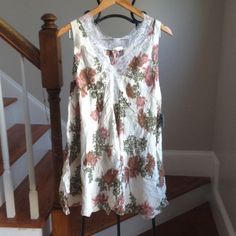 Free People Slip Dress Final Price! Going fast ! Sells for $88 on free people site now. Could be worn as a night dress or a top with a tunic under it. I have one that I wear over my bathing suit. Free People Tops