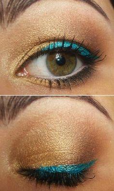 Mooi! Gouden oogschaduw met een fel gekleurd lijntje.