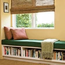 Another window seat, just like the idea with bookshelf underneath.