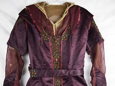 Deep eggplant purple silk bodice with netting and multi-colored beading, circa 1910 via eBay | This bodice once was a full dress, but the lush purple silk of the skirt was hacked off at some point, leaving only the top half.