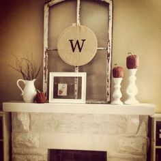 Fall mantle decor... i like the owl in the open frame