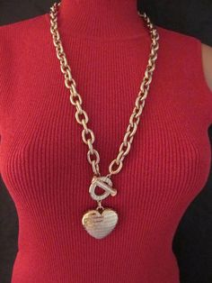 Dress in romance with the allure of this sleek, large heart shaped pendant necklace. Givenchy signed toggle and pendant dangle from a thick linked chain.  #Necklace #Givenchy #stuff4Uand4U http://stores.ebay.com/Stuff4Uand4U
