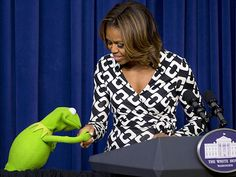 Star Tracks: Thursday, March 13, 2014 | GOING GREEN | How sweet! Kermit the Frog plants a smooch on First Lady Michelle Obama's hand during an event for children of military families Wednesday at the White House in Washington, D.C., where the kids were also treated to a screening of Muppets Most Wanted.