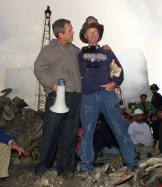 President George W Bush with volunteer firefighter amidst rubble of the World Trade Towers We Are The World, In This World, George W Bush, World Trade Center Buildings, 11 September 2001, We Will Never Forget, Iconic Photos, Sad Day, God Bless America