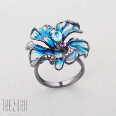 Flower Ring. Oxidised sterling silver with enamel and glass inserts and Cubic…