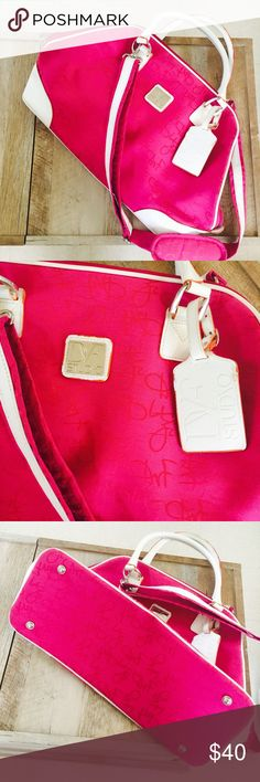 """• DVF Studio Luggage Bag • Very big. Good for carry on. Has some markings and normal wear. The inside zipper seems to have factory sowing got caught up with the hem. Color is pink and white. Has a small rip on the bottom. Doesn't affect the wear.  19"""" in length. 7.5 inches in the width of the bottom. And 13 1/2 inches of the height. Can also be used as a weekend bag. Diane Von Furstenberg Bags Travel Bags"""