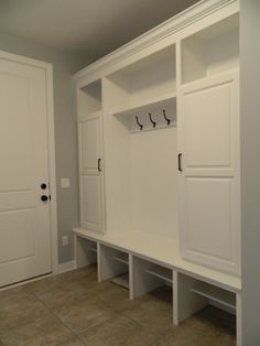 Bon Custom Built In Painted White With Crown Molding. Oil Rubbed Bronze Door  Hardware And Hooks.