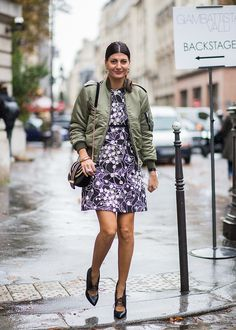 A green bomber jacker and a printed dress
