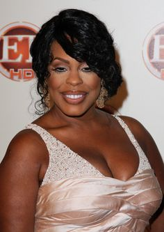 Niecy Nashs long, curly hairstyle