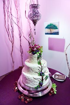 White tiered wedding cake with bright purple accents, photo by Callaway Gable Photography