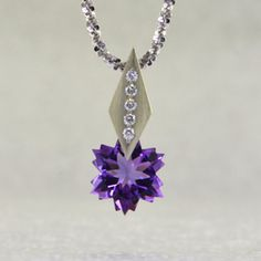 This Amethyst snowflake and Diamond Piercette® pendant will melt your heart.