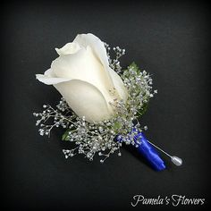 Boutonniere by Pamela's Flowers - Full-size white rose, silver sparkle babies…
