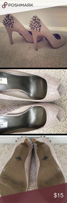 Simply Vera Wang peep toe pumps Snake skin like material with spikes and gems on back. About a 4 in heal size 7 1/2  I purchased thinking my feet were smaller :). Sadly after one wear these are way to painful for me!!!!! These is some exposed glue on the inside. I'm not sure if this was thee when I bought them and over time in my closet had yellowed? You can tell from the bottom heel that they are practically almost new.  Can post more pictures upon request :) color is like a dusty beige…