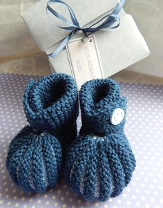 A personal favourite from my Etsy shop https://www.etsy.com/uk/listing/209101316/blue-baby-booties-hand-knitted-in