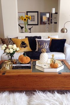 On this sofa I piled on loads of texture - rich velvet, soft chenille, and cozy faux fur. The colors are dramatic! I especially like the yellowish gold with black, and the boldness of the embroidered bumble bee pillow. The velvet plush pumpkins are the perfect accent from HomeGoods. Sponsored by HomeGoods