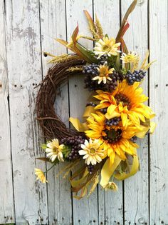 Summer Sunflower Grapevine Wreath-like sunflowers with  grapes, daisies and mixed greenery.