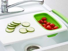 The Sink Drainer Cutting Board is an over the sink cutting board with strainer that is perfect for a small kitchen with little counter space!