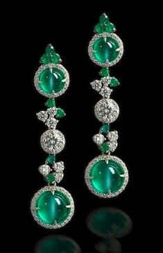 A pair of cat's eye emerald and diamond pendent earrings Each formed as a series of three 'target' design plaques, two of which are set with a round cabochon cat's eye emerald surrounded by a row of brilliant-cut diamonds, the central plaque set with a br Emerald Earrings, Emerald Jewelry, Dangle Earrings, Silver Earrings, Stone Earrings, Bridal Earrings, Crystal Earrings, Silver Ring, Pendant Necklace