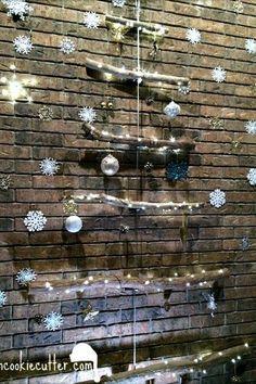 s 20 fake christmas trees you ll wish you d seen sooner, christmas decorations, repurposing upcycling, seasonal holiday decor, Hanging Branch Beauty