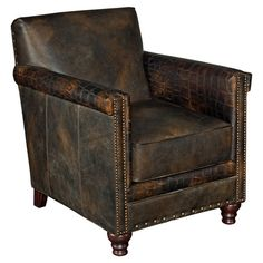 A handsome addition to your study or living room, this leather-upholstered arm chair showcases croc-inspired details and nailhead trim.