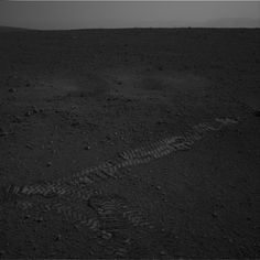 The rover (and her driving team) has done it! Curiosity has taken a little jaunt inside Gale Crater and here is an image of the wheel tracks to prove it! This image was taken by the right Navigation Camera on the rover Curiosity on Sol 16 (2012-08-22 15:00:53 UTC).