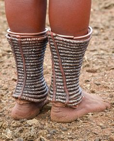 Elaborate Himba ankle decoration made from hammered steel nuts  | © Tim Thornton.