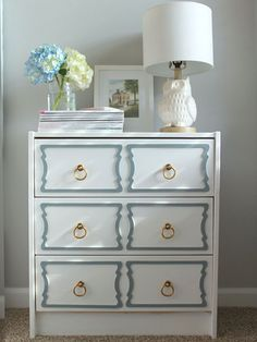 DIY Ikea Rast Hacks - iVillage  bright gold handles & grey/blue (Rustoleum) spray painted overlays.