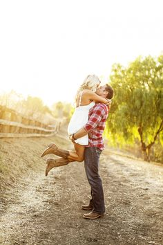 So so cute! LOVE her cowgirl boots! :) #engagement #wedding #country