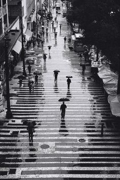 Rain in black and white, by ppucci, São Paulo, Brazil.  I like the horizontal lines in the street.  Comment by dapoirier. https://www.pinterest.com/dapoirier/photography/