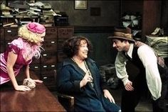 "Kristin Chenoweth as Lily St. Regis, Alan Cumming as Rooster Hannigan, and Kathy Bates as Miss Hannigan in the show-stopping, ""Easy Street"" sequence from the 1999 television version of ""Annie""."