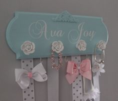 Some sort of bow holder like this or similar.   bow holder, monogram hair bow holder, bow organizer, girl nursery decor, girl baby shower gift, headband holder, blue and silver, baby girl by WinsomeWalls on Etsy https://www.etsy.com/listing/266433890/bow-holder-monogram-hair-bow-holder-bow