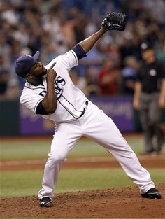Tampa Bay Rays relief pitcher Fernando Rodney gestures after striking out the last Houston Astros batter during the ninth inning of a baseball game on Saturday, July 13, 2013, in St. Petersburg, Fla. Tampa Bay defeated Houston 4-3. (AP Photo/Scott Iskowitz)