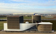 Sustainable Office Buildings Connected by Large Twisted Concrete Mass