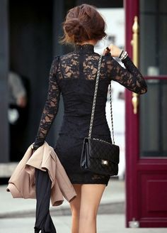 Black lace dress and quilted purse.