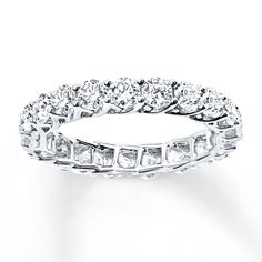 Sparkling round diamonds encircle the band of this stunning eternity ring, suggesting a love that never ends. Crafted of white gold, the ring has a total diamond weight of 2 carats. Diamond Total Carat Weight may range from - carats. Eternity Ring Diamond, Diamond Stone, Diamond Rings, Diamond Jewelry, Eternity Bands, Metal Jewelry, Fine Jewelry, Jewelry Box, Jewellery