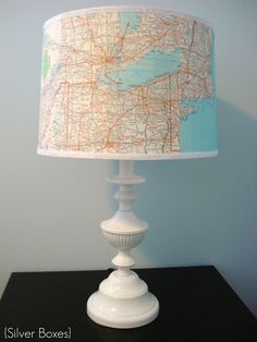 Cut maps into equal pieces and stick to lamp with Mod Podge - easy! #Upcycle
