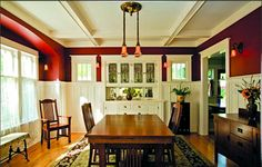 Another craftsman interior with painted interior architectural features. Red paint color and wood furniture enhance the choice to paint the interior surfaces.